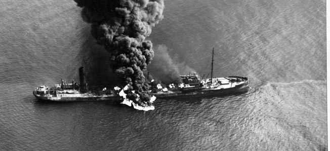 American tanker SS Byron D. Benson burns after being torpedoed off North Carolina, April 4, 1942. Ten of 37 crewmen died.