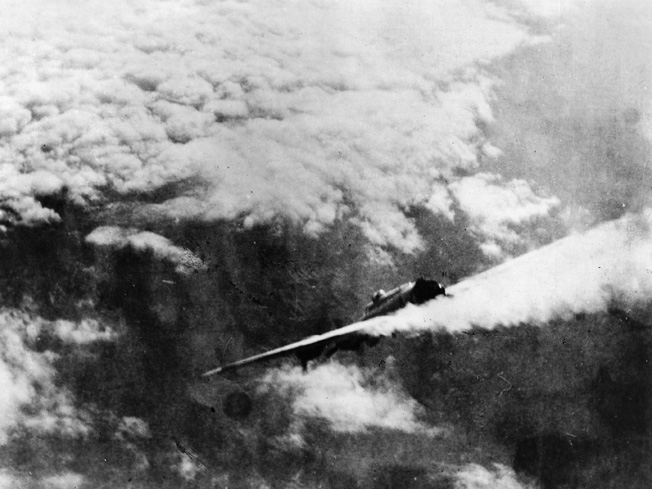 The forward half of a B-17 plunges to earth after colliding with another bomber. There were no survivors.