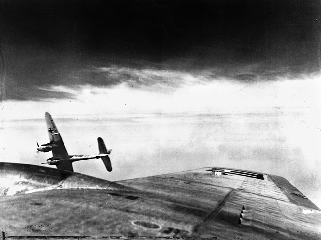 A twin-engine Messerschmitt Bf 110 banks sharply to avoid a collision with a B-17 above Germany, June 21, 1944.