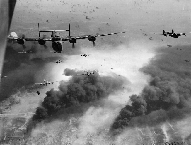 A formation of Consolidated B-24s leaves behind the burning, German-controlled Ploesti, Romania, oil-production facilities, May 31, 1944.