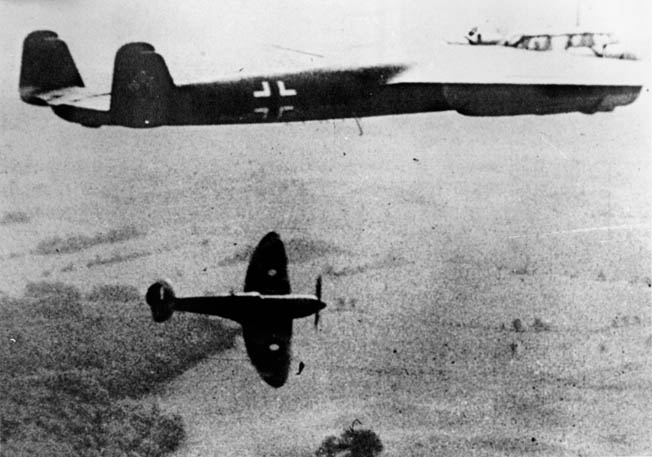 A Spitfire shadows a German Dornier 17 light bomber shortly after the Battle of Britain as enemy daylight raids against England became fewer.