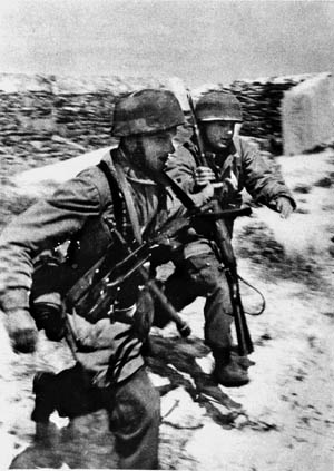 """German glider infantrymen assault the supposedly """"impregnable"""" Belgian fortress of Eben Emael near Liege, May 10, 1940. The fort's garrison surrendered after just a few hours."""