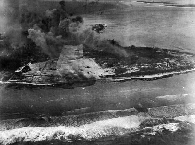 """Smoke rises from Eniwetok after pre-invasion """"softening-up"""" attacks by U.S. Navy carrier aircraft on February 3, 1944."""