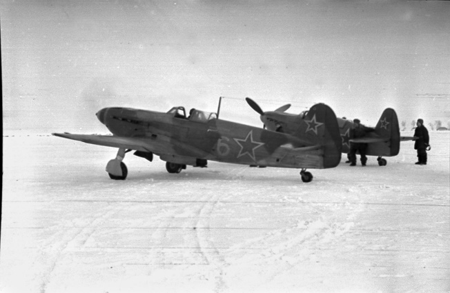A French pilot prepares to take off from a snowy Soviet airfield. Brutally cold temperatures hampered operations.