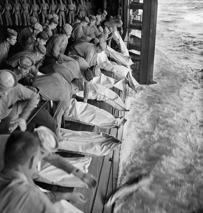 Officers and men of the USS Intrepid, killed during the Battle of Leyte Gulf, are buried at sea, November 1944.