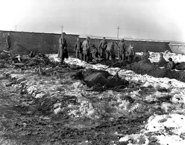 German prisoners of war dig graves for members of the 101st Airborne killed defending Bastogne.