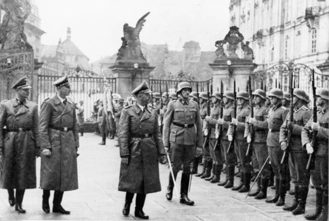 September 1941: Himmler and Reinhard Heydrich (second from left), the military governor of Czechoslovakia and the person who carried out many of Himmler's most diabolical schemes (such as the Holocaust), review SS guards at the Hradcany Palace in Prague. Heydrich was ambushed by Czech partisans the following May and died of his wounds.