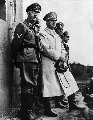 Himmler and Hitler, along with other officers, view live-fire military exercises at the Münsterlager training area, May 20, 1939.