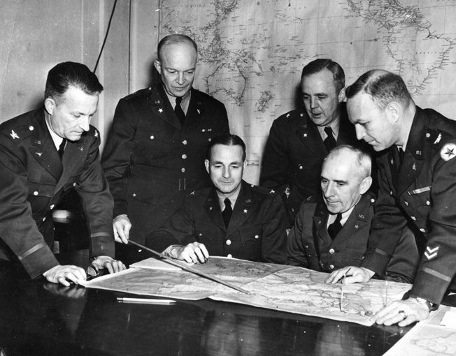 A War Plans Board meeting, May 1942. Shown are (left to right) Colonel St. C. Street, Ike, Cololnel A.S. Nevins, Brig. Gen. R.C. Crawford, Colonel C.A. Russell, and Colonel H. A. Barber, Jr.