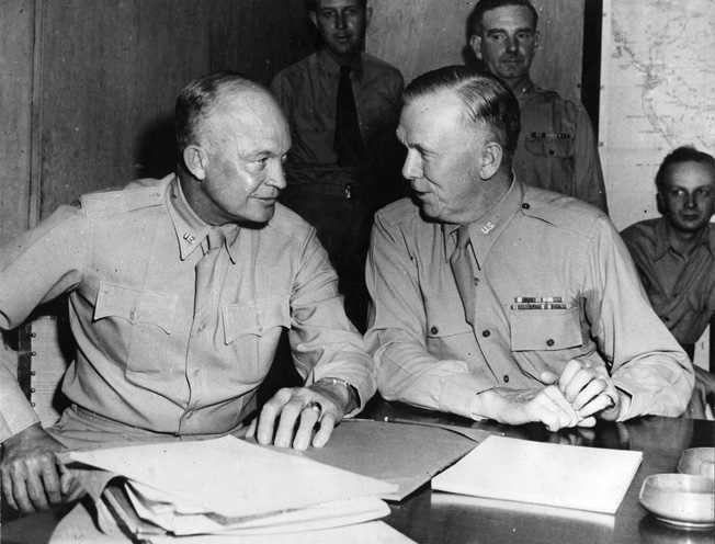 Eisenhower, now a four-star general, confers with Army Chief of Staff General George C. Marshall during President Roosevelt's meetings with Churchill in North Africa, June 1943.