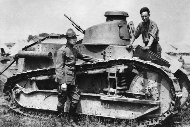 Lt. Col. Eisenhower (in campaign hat) stands next to a Renault FT-17 light tank during maneuvers at Camp Colt, Pennsylvania, in 1918. His dour expression may be due to his being denied the chance to see combat in France.