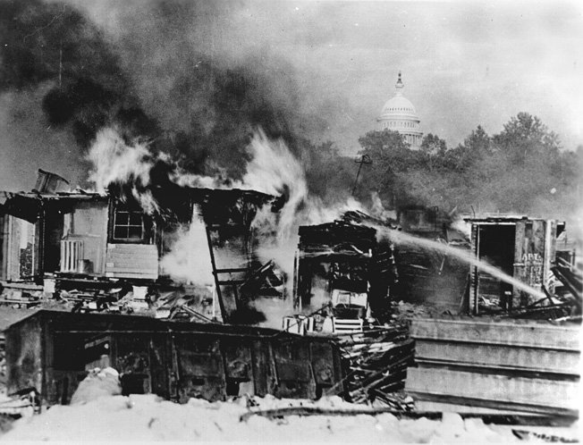 "Shacks constructed on the Anacostia Flats by the so-called ""Bonus Army"" in Washington, D.C., ablaze after an ugly confrontation with the U.S. Army, summer 1932."
