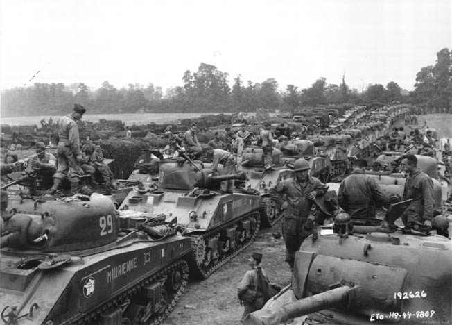Men of General Jacques-Philippe Leclerc's 2nd French Armored Division, driving Shermans and wearing American uniforms, are shown shortly after arriving in France at Normandy and before beginning the liberation of their homeland.
