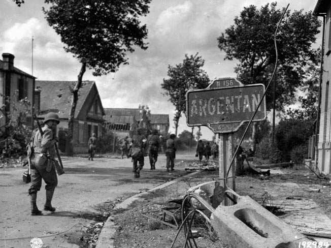GIs enter the damaged French village of Argentan, August 20, 1944, where the closing of the gap came too late to prevent the German withdrawal from being partially successful.