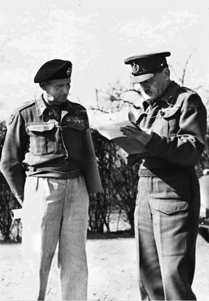 "Montgomery (left) and ""Freddie"" De Guingand, his chief of staff, review a document. It was De Guingand who passed the order instructing the Americans to halt and not close the gap at Falaise."