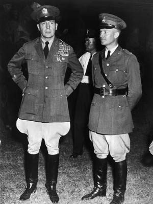 "Army Chief of Staff General Douglas MacArthur and his aide, Major Eisenhower, during the ""Bonus Army"" conflict."