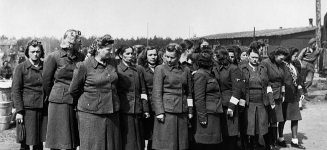 A group of female SS guards (Aufseherinnen) photographed on parade at Bergen-Belsen in 1945.