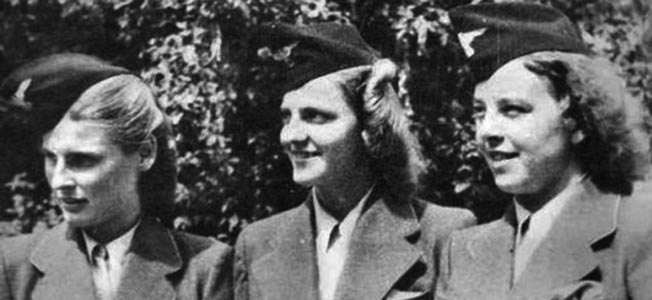 Grese (center, with two other Aufseherin at an unidentified location in 1941) always did everything to appear well-dressed and perfectly coiffed.