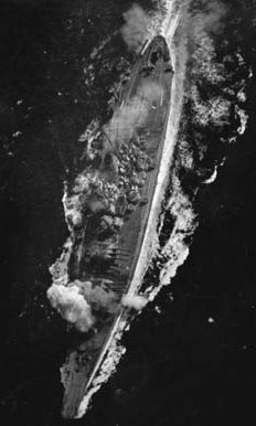 A view of the battleship Yamato as a bomb explodes near her forward 460mm gun turret during the Battle of the Sibuyan Sea on October 20, 1944. Although considered huge when she was commissioned in December 1941 (she was 266 feet longer and 44,000 tons heavier than the USS Texas, which had been commissioned in 1914), by the time she saw action, American battleships of the Iowa class were nearly as big.