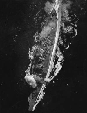 A view of the Yamato as a bomb explodes near her forward 460mm gun turret during the Battle of the Sibuyan Sea on October 20, 1944. Although considered huge when she was commissioned in December 1941 (she was 266 feet longer and 44,000 tons heavier than the USS Texas, which had been commissioned in 1914), by the time she saw action, American battleships of the Iowa class were nearly as big.