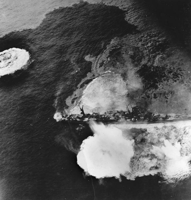 All Japanese ships were fair game at Okinawa. Here a light cruiser of the Agano class is pummeled by American warplanes.