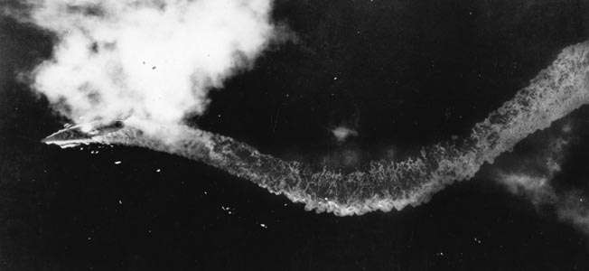 Yamato's captain steers violently to avoid bombs and aerial torpedos, but the end is near.