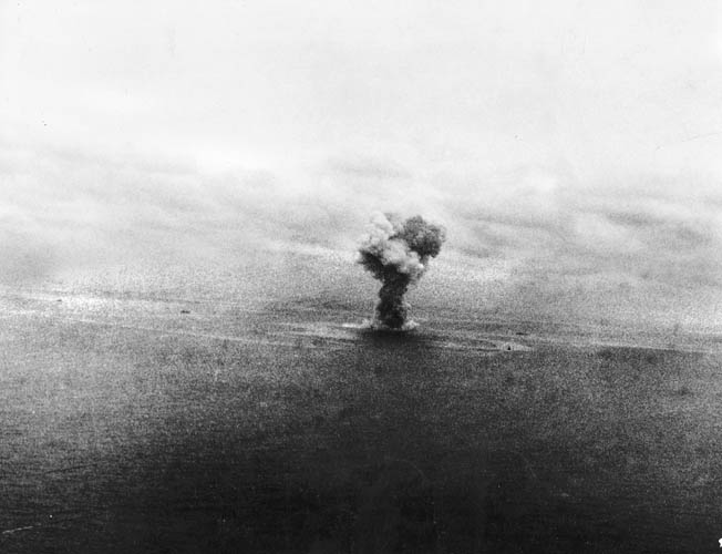 Hit by eight aerial torpedoes, the Yamato explodes in a giant plume of smoke and fire. Only 592 of her 3,332-man crew survived.