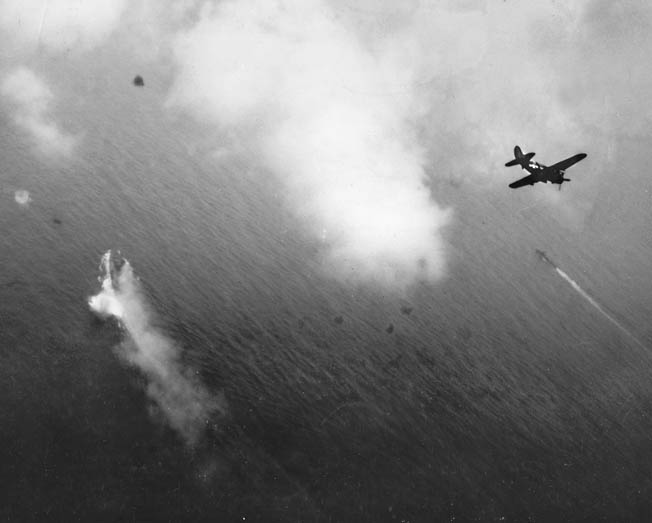 American dive- bombers, probably from the Yorktown, bank into the attack on the Yamato (left).