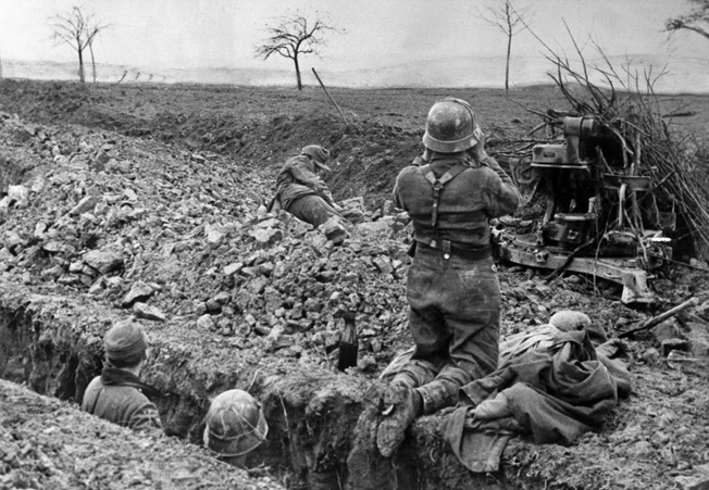 German troops occupy muddy trenches on the Saar front in anticipation of Patton's attacks, December 1944.