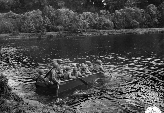 On September 8, men of the 5th Infantry Division cross the Moselle River near Dornot, France, five miles south of Metz.
