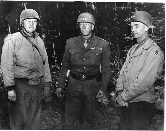 Patton with General Manton Eddy (left), commander of XII Corps, and General Horace McBride, commander of the 80th Infantry Division.