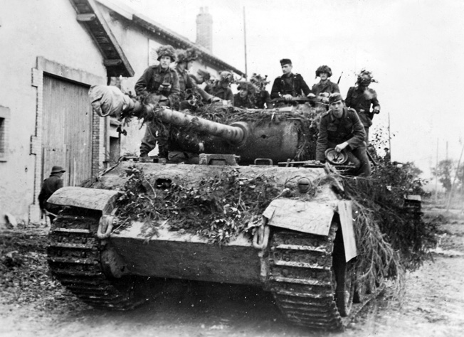 A German Panther Ausf. A, covered in camouflage—and camouflaged soldiers—prepares to engage U.S. forces in the Lorraine region, September 1944.