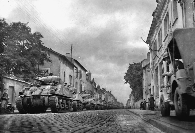 Shermans line up in an unidentified French city, September 27, 1944, in preparation for a continuation of the drive toward the German border.