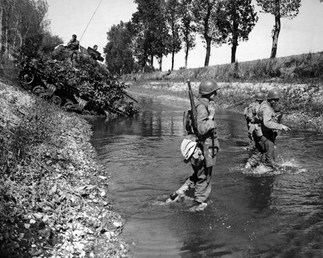 Men of the 35th Infantry Division cross the Marne-Rhine Canal, September 15, 1944.