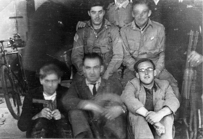 Walter Leginski and Everett Rideout were photographed with their Dutch Underground rescuers. Chris Moerland is at left, front.