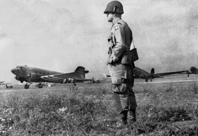 Captain Adam Kosoma, 82nd Airborne, observes C-47s preparing for take-off from RAF Spanhoe. BELOW: Second Lieutenant Douglas Felber, copilot of Bette, was killed when the plane crashed in flames.