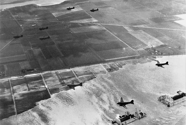 A formation of C-47s carries Allied paratroopers over flooded Dutch fields, September 17, 1944.