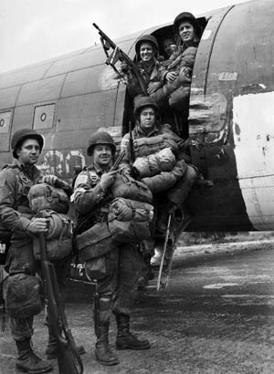 A mixture of elation and apprehension is visible on the faces of these heavily laden American paratroopers as they board their C-47 transport plane at the start of Operation Market-Garden.