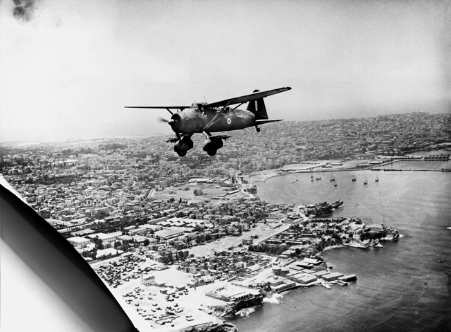 An RAF Westland Lysander Mark I flies over the Beirut waterfront shortly after the city fell to the British in July 1941.