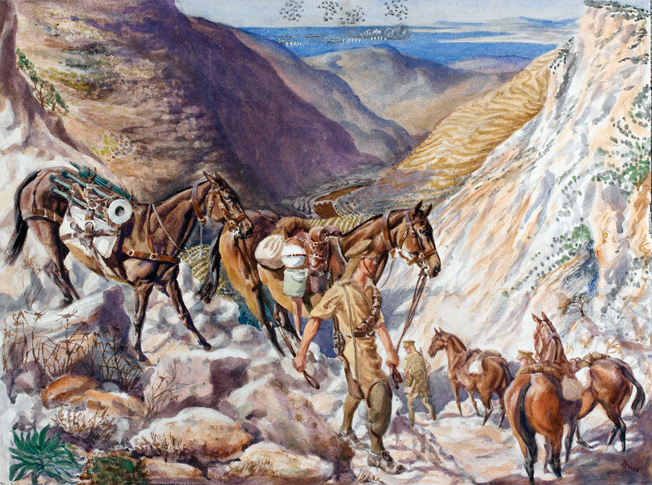 British troops lead a pack-horse train through a rugged mountain pass in Lebanon.