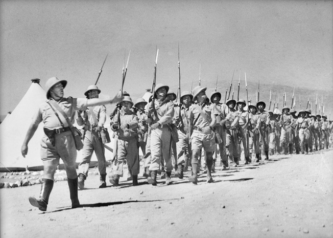 Free French troops, part of two brigades brought in to fight against their countrymen, march on parade near Damascus once the city fell on June 22, 1941.