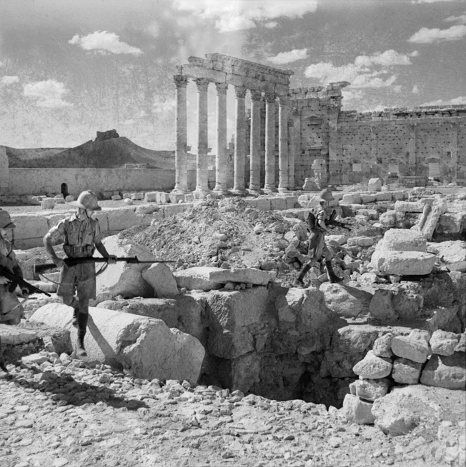 British troops search for snipers amid the ancient ruins of the Temple of Baal Shamin at Palmyra, Syria, in July 1941.
