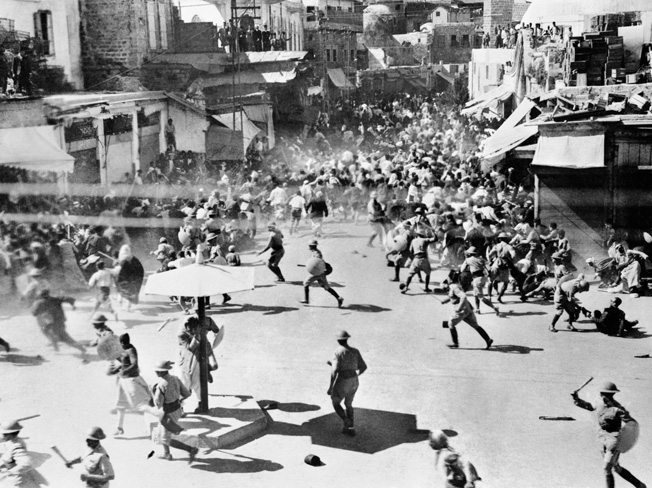 Club-wielding British troops force Palestinian rioters to disperse during a demonstration in 1933.