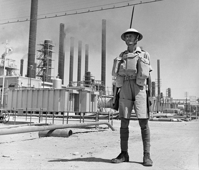 An Indian soldier stands guard at a vital oil refinery near Abadan, Iran, September 1941.