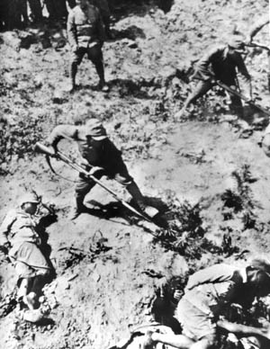 A Japanese soldier bayonets a Chinese POW whose hands and feet are bound. To many Japanese soldiers, anyone who surrendered had dishonored his uniform and did not deserve to live.