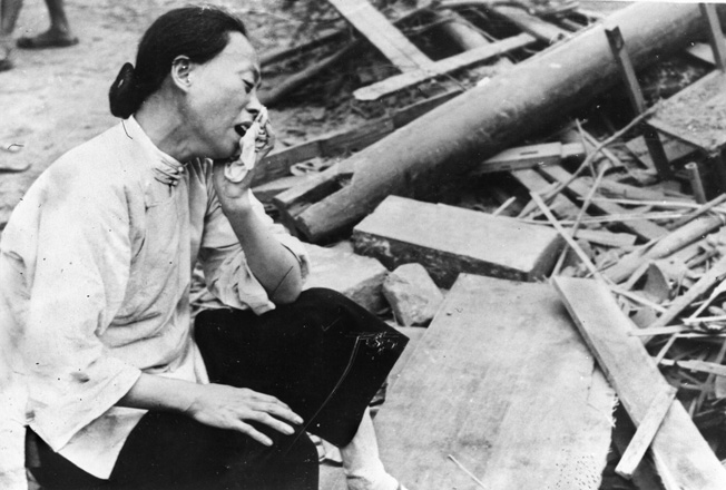 A Chinese woman weeps for her husband and children, killed during a Japanese bombing raid.
