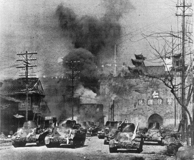 A formation of Japanese tanks advances on Nanking's Gate of China, December 12, 1937.