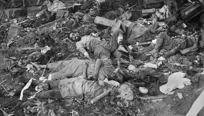 Dead Japanese soldiers lie in a neglected heap after the final Allied push to victory at Gona, New Guinea. This photo was taken in December 1942.