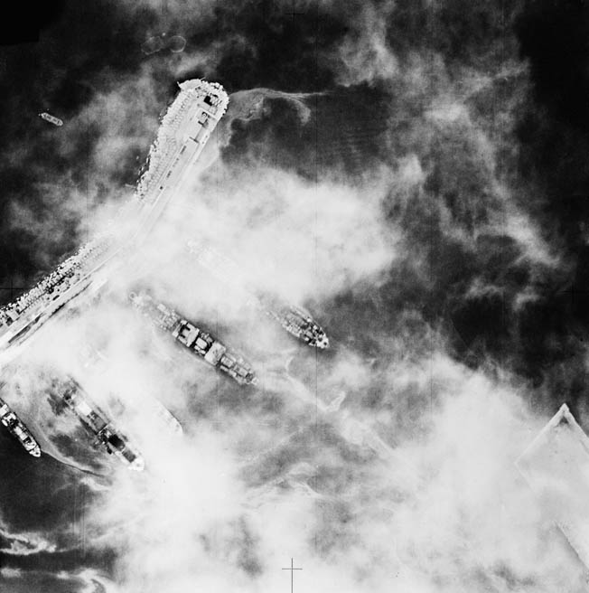 A British reconnaissance photo shows ships of an Italian convoy in the harbor at Palermo, Sicily. Two of the vessels were sunk and others damaged during a bombing raid two nights later.
