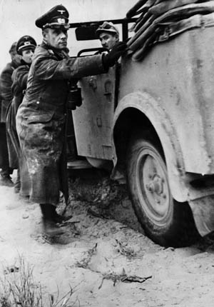 Although a brilliant tactician, General Erwin Rommel (shown here helping to push his command car out of deep desert sand in February 1942) was unable to overcome his dwindling resources.